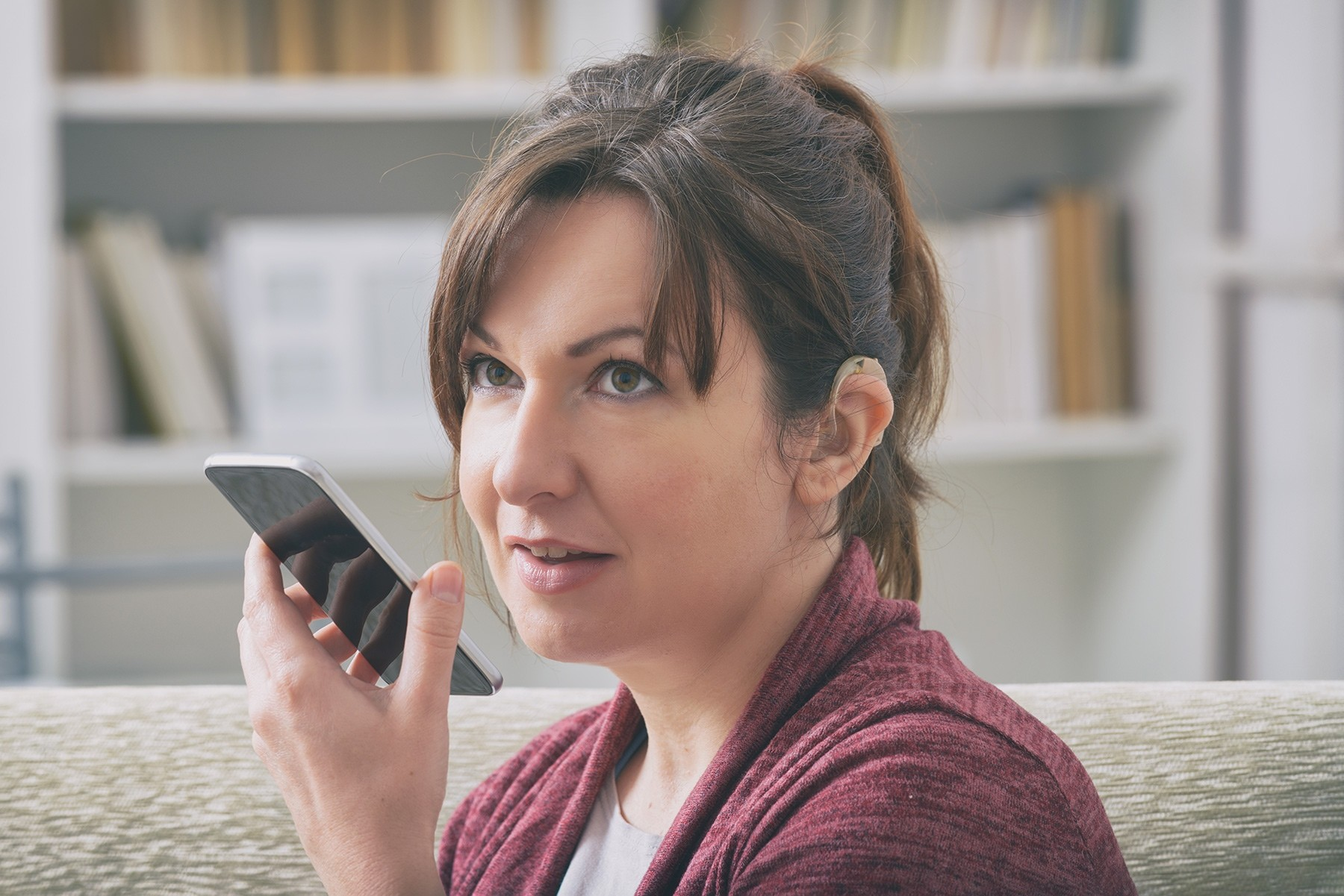 Woman Talking Into Mobile Phone